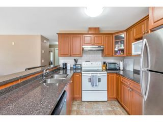 """Photo 12: 201 16718 60 Avenue in Surrey: Cloverdale BC Condo for sale in """"MCLELLAN MEWS"""" (Cloverdale)  : MLS®# R2486554"""