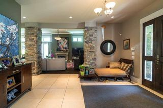 Photo 3: 1079 LODGE Road in North Vancouver: Canyon Heights NV House for sale : MLS®# R2592498