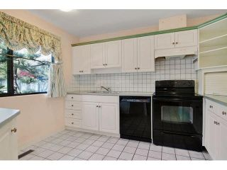 """Photo 2: 417 4001 MT SEYMOUR Parkway in North Vancouver: Roche Point Townhouse for sale in """"THE MAPLES"""" : MLS®# V1115276"""