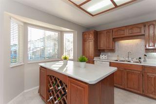"Photo 9: 15720 95 Avenue in Surrey: Fleetwood Tynehead House for sale in ""Bel-Air Estates"" : MLS®# R2359980"