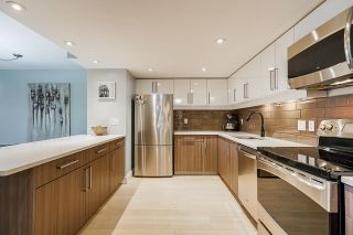 """Photo 3: 102 1450 PENNYFARTHING Drive in Vancouver: False Creek Condo for sale in """"HARBOUR COVE"""" (Vancouver West)  : MLS®# R2560607"""