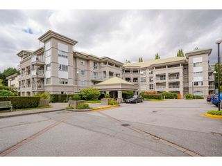 """Photo 1: 114 10533 UNIVERSITY Drive in Surrey: Whalley Condo for sale in """"Parkview Court"""" (North Surrey)  : MLS®# R2612910"""