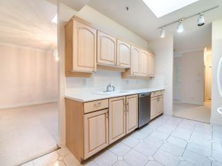 """Photo 20: 305 3766 W 7TH Avenue in Vancouver: Point Grey Condo for sale in """"THE CUMBERLAND"""" (Vancouver West)  : MLS®# R2583728"""