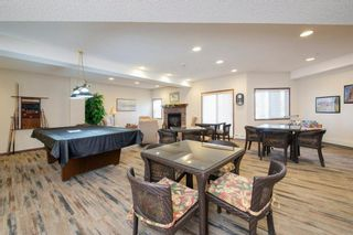 Photo 18: 101 72 Quigley Drive: Cochrane Apartment for sale : MLS®# A1091486