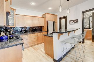 Photo 13: 1, 3421 5 Avenue NW in Calgary: Parkdale Row/Townhouse for sale : MLS®# A1057413