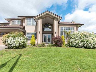 """Photo 1: 14287 69A Avenue in Surrey: East Newton House for sale in """"East Newton"""" : MLS®# R2574011"""