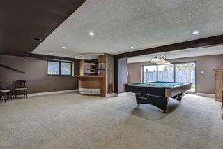 Photo 31: 512 Coach Grove Road SW in Calgary: Coach Hill Detached for sale : MLS®# A1127138