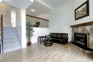 Photo 14: 24 GLAMIS Gardens SW in Calgary: Glamorgan Row/Townhouse for sale : MLS®# A1077235