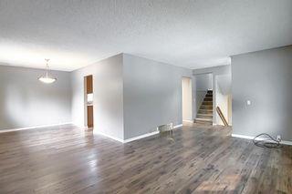 Photo 5: 844 LAKE LUCERNE Drive SE in Calgary: Lake Bonavista Detached for sale : MLS®# A1034964