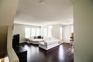 Photo 2: 50 Auburn Bay Common SE in Calgary: Auburn Bay Row/Townhouse for sale : MLS®# A1128928