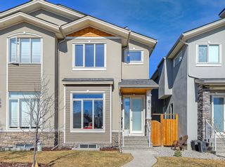 Photo 1: 646 24 Avenue NW in Calgary: Mount Pleasant Semi Detached for sale : MLS®# A1082393