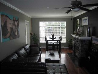"""Photo 3: # 410 3625 WINDCREST DR in North Vancouver: Roche Point Condo for sale in """"WINDSONG 111 @ RAVEN WOODS"""" : MLS®# V930131"""