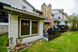 Photo 33: 85 Coachway Gardens SW in Calgary: Coach Hill Row/Townhouse for sale : MLS®# A1110212