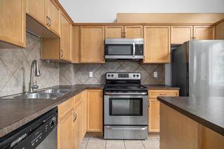 Photo 9: 5 Cougar Ridge Mews SW in Calgary: Cougar Ridge Row/Townhouse for sale : MLS®# A1105171