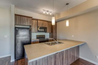 Photo 8: 9308 101 Sunset Drive: Cochrane Apartment for sale : MLS®# A1079009