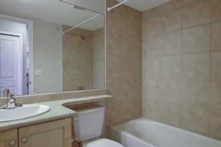 Photo 30: 7402 304 MacKenzie Way SW: Airdrie Apartment for sale : MLS®# A1081028