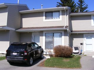 Main Photo: 202 Pinestream Place NE in Calgary: Pineridge Row/Townhouse for sale : MLS®# A1097730