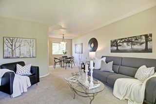 Photo 1: 108 Langton Drive SW in Calgary: North Glenmore Park Detached for sale : MLS®# A1009701