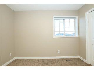 Photo 31: 74 WEST TERRACE Road: Cochrane House for sale : MLS®# C4073559