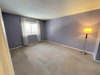 Photo 21: 15 Coach Side Terrace SW in Calgary: Coach Hill Row/Townhouse for sale : MLS®# A1071978