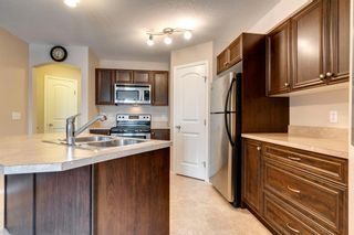 Photo 10: 104 20 Panatella Landing NW in Calgary: Panorama Hills Row/Townhouse for sale : MLS®# A1117783
