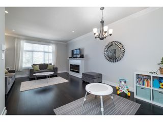 """Photo 3: 8 16458 23A Avenue in Surrey: Grandview Surrey Townhouse for sale in """"Essence at the Hamptons"""" (South Surrey White Rock)  : MLS®# R2380540"""