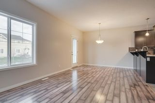 Photo 11: 48 Arbours Circle NW: Langdon Row/Townhouse for sale : MLS®# A1045296