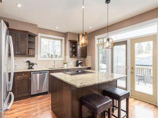 Photo 8: 40 ROSSDALE Road SW in Calgary: Rosscarrock Semi Detached for sale : MLS®# A1046518