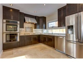 Photo 10: 31 HIGHWOOD Place NW in Calgary: Highwood Residential Detached Single Family for sale : MLS®# C3639703