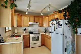 Photo 3: 113 Edgar Avenue NW: Turner Valley Semi Detached for sale : MLS®# A1101043