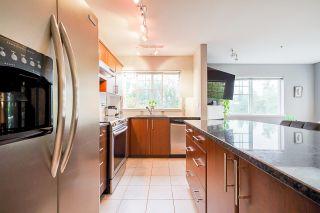 "Photo 2: 203 19366 65 Avenue in Surrey: Clayton Condo for sale in ""Liberty"" (Cloverdale)  : MLS®# R2624886"