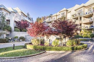 """Photo 1: 214A 301 MAUDE Road in Port Moody: North Shore Pt Moody Condo for sale in """"Heritage Grand"""" : MLS®# R2466859"""