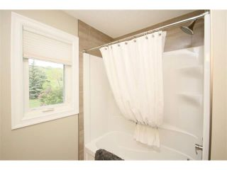 Photo 32: 156 GLENEAGLES Close: Cochrane House for sale : MLS®# C4018066