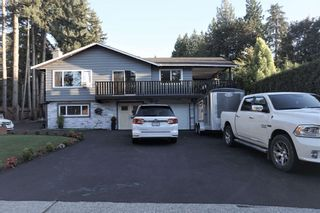 Photo 1: 19994 39A Avenue in Langley: Brookswood Langley House for sale : MLS®# R2596970