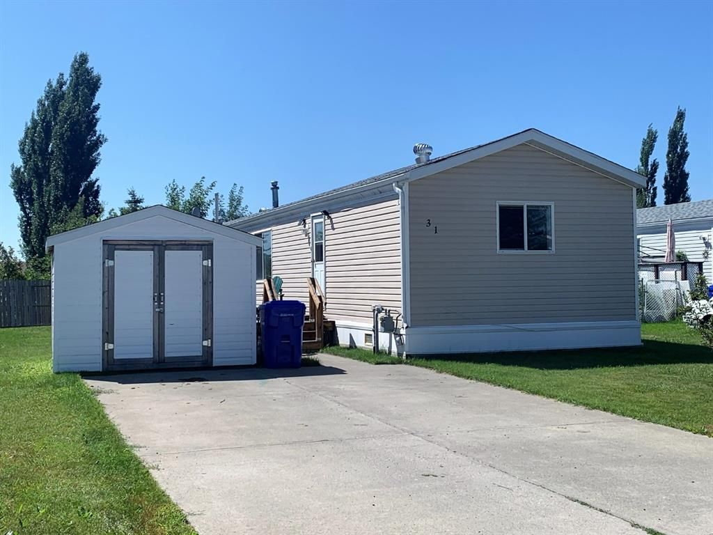 Front Exterior.  Shed included.
