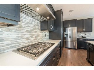 Photo 5: 22 ROCKFORD Road NW in Calgary: Rocky Ridge House for sale : MLS®# C4115282