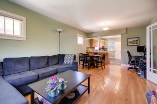 Photo 7: 3118 39 Street SW in Calgary: Glenbrook Detached for sale : MLS®# A1105435