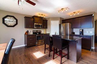 Photo 4: 306 FIRESIDE Place: Cochrane House for sale : MLS®# C4137461