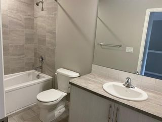 Photo 21: 732 Osborne Drive SW: Airdrie Row/Townhouse for sale : MLS®# A1133429