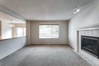 Photo 8: 7854 Springbank Way SW in Calgary: Springbank Hill Detached for sale : MLS®# A1142392
