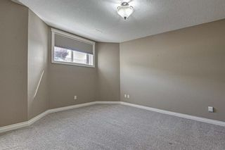 Photo 20: 72 Elysian Crescent SW in Calgary: Springbank Hill Semi Detached for sale : MLS®# A1148526