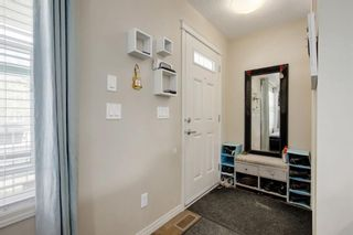 Photo 2: 203 CRANBERRY Park SE in Calgary: Cranston Row/Townhouse for sale : MLS®# A1063475