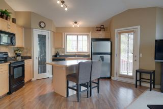 Photo 4: 206 7 EVERRIDGE Square SW in Calgary: Evergreen Row/Townhouse for sale : MLS®# A1037187