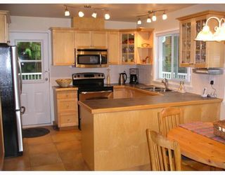 Photo 5: 936 BAKER Drive in Coquitlam: Chineside House for sale : MLS®# V798614