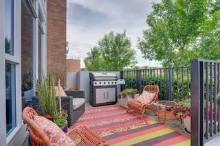 Photo 3: 113 Confluence Mews SE in Calgary: Downtown East Village Row/Townhouse for sale : MLS®# A1138938