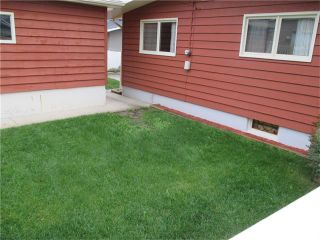 Photo 19: 5735 LADBROOKE Drive SW in Calgary: Lakeview House for sale : MLS®# C4031182