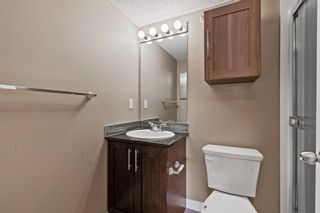 Photo 14: 7411 403 Mackenzie Way SW: Airdrie Apartment for sale : MLS®# A1152134