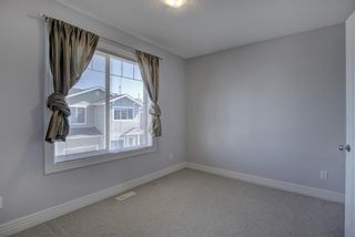 Photo 20: 76 Bridleridge Manor SW in Calgary: Bridlewood Row/Townhouse for sale : MLS®# A1106883
