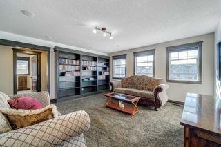 Photo 29: 102 Ridge View Place: Cochrane Detached for sale : MLS®# A1147672