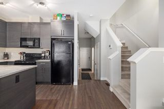 Photo 7: 205 Jumping Pound Common: Cochrane Row/Townhouse for sale : MLS®# A1138561